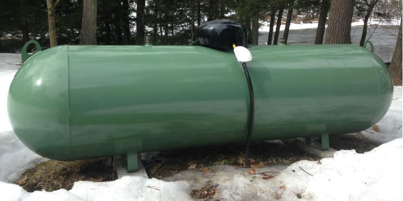 A propane tank in backyard